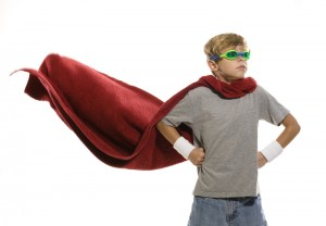 Boy with cape and goggles
